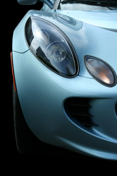 1016909-isolated-blue-sports-car-on-black